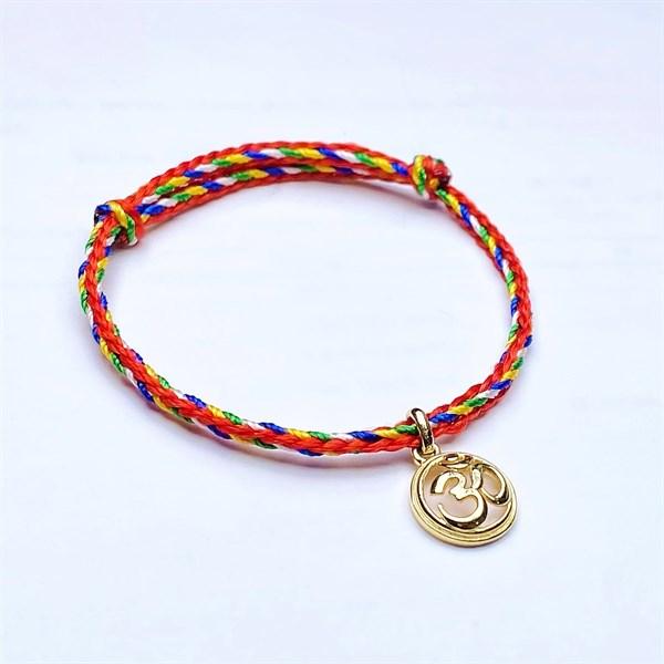 Vòng thắt dây chỉ Nepal phối charm Ohm vàng HBL-0202